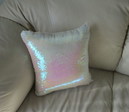 White translucent sequence couch pillow